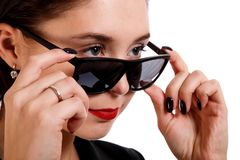 Woman in a sunglasses. Isolated over white background stock image