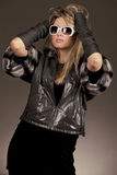 Woman with sunglasses and leather jacket Stock Images