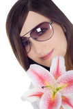 Woman in sunglasses with lili Stock Photography