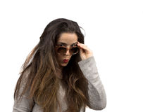 Woman with sunglasses and long hair makes surprised expression Stock Photos