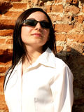 Woman with sunglasses looking to the future2. Business woman wearing sunglasses looking to the future smiling royalty free stock images