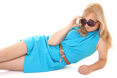Woman in sunglasses lying isolated over white Stock Photography