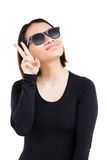 Woman in sunglasses making a v sign Royalty Free Stock Image