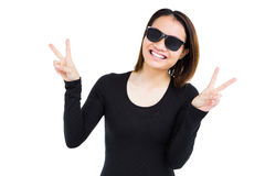 Woman in sunglasses making a v sign Stock Photography
