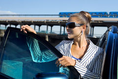 Woman in sunglasses near the car Royalty Free Stock Photos
