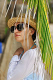 Woman in sunglasses near palm tree Royalty Free Stock Photo