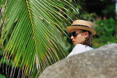 Woman in sunglasses near palm tree Royalty Free Stock Image