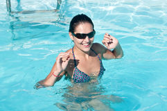 Woman with sunglasses in pool Stock Image