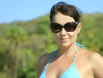 Woman in sunglasses posing on tropical beach Royalty Free Stock Photo