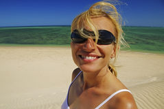 Woman With Sunglasses Relaxing On The Beach Royalty Free Stock Photography