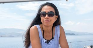 Woman with sunglasses on sailboat royalty free stock image