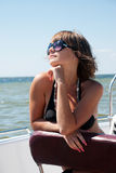 Woman in sunglasses at the sea Royalty Free Stock Photography