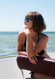 Woman in sunglasses at the sea Stock Images