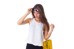Woman with sunglasses and shopping bag Royalty Free Stock Image