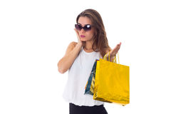 Woman in sunglasses with shopping bags Royalty Free Stock Photo