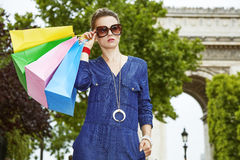 Woman in sunglasses with shopping bags near Arc de Triomphe Royalty Free Stock Image