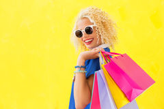 Woman with sunglasses and shopping bags Stock Photography