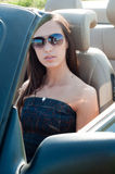 Woman in sunglasses sitting in cabrio Royalty Free Stock Image