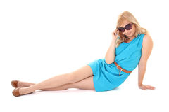 Woman in sunglasses sitting isolated over white Royalty Free Stock Images