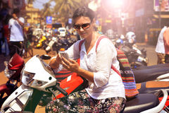 Woman in sunglasses sitting on motorcycle Royalty Free Stock Photos