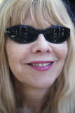 Woman in sunglasses smiling into camera in Ojai, California, USA Royalty Free Stock Photography