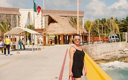 Woman in sunglasses stand on quay, Costa Maya, Mexico. Costa Maya, Mexico - February 01, 2016: woman in sunglasses stand on quay at sea on sunny day. Summer stock photography