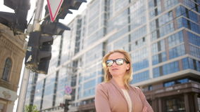 Woman in sunglasses standing on a busy street. woman, a resident of the city. Young woman in sunglasses standing on a busy street. woman, a resident of the city stock video footage
