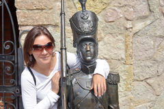 Woman with sunglasses and a statue Stock Photos