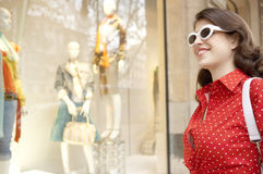 Woman with Sunglasses at Store Window Royalty Free Stock Images