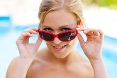 Woman with sunglasses and sun cream Stock Photo