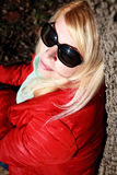 Woman in sunglasses at sunset, autumn park Royalty Free Stock Photo