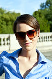 Woman with sunglasses on the trip Royalty Free Stock Images