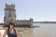 Woman woman with sunglasses, on vacation in Lisbon, Portugal, Eu. Woman with sunglasses, on vacation in Lisbon, the Belen tower in the background, together with stock image