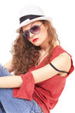 Woman in sunglasses and a white hat Stock Image