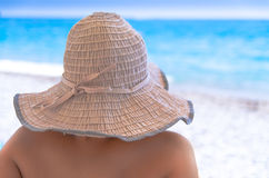 Woman in sunhat on beach Stock Photography
