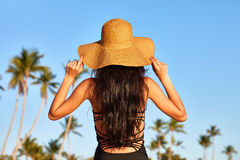 Woman in sunhat on a beach Stock Image