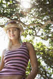 Woman In Sunhat Under Tree Stock Photo