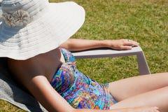 Woman sunning herself Stock Photography