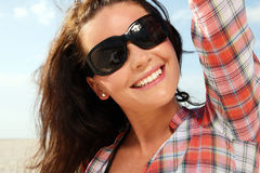 Woman at sunny beach. Stock Images