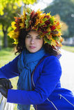 Woman at sunny day with leaf wreath Stock Images