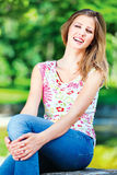 Woman on sunny day in park Royalty Free Stock Photo