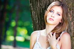 Woman on sunny day in park Stock Photo