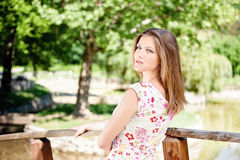 Woman on sunny day in park. Cute brunette woman on sunny day in park, outdoor Royalty Free Stock Images