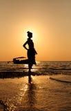 Woman sunrise boat Stock Images