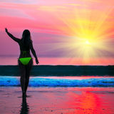 Woman at sunrise time Royalty Free Stock Photography
