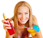 Woman with sunscreen and cocktail Royalty Free Stock Photography