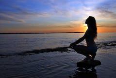 Woman and sunset Stock Photos