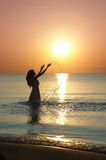 Woman at sunset Stock Photos
