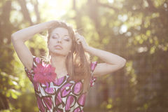 Woman in the sunset Royalty Free Stock Photos