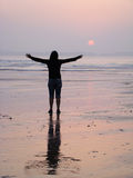 Woman at Sunset. Woman with open arms at sunset Royalty Free Stock Photos